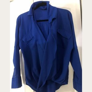 Blue low front blouse by Naked Zebra